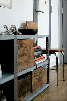 Industrial metal shelving, vintage wooden shipping crates, jacks. From The New York Times Home & Garden