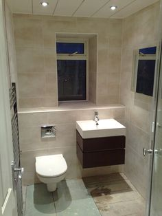 Shower room fitted with concealed toilet cistern and wall hung basin on wooden cabinet.jpg 1,944×2,592 pixels