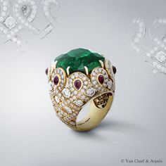 Pongal ring, Pierres de Caractère Variations collection Yellow gold, diamonds, cabochon-cut rubies,one cushion-cut emerald. Van Cleef