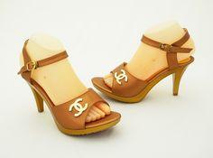 Sandal heels elegan, warna gold.  Nyaman di kaki. Heels 9 cm.  Bahan kulit sintetis dan kanvas satin.  Visit: www.qiblacorner.com, or www.facebook.com/webqiblacorner
