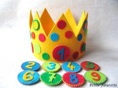 Kunterbunte Geburtstagskrone zum Schmücken des Geburtstagskindes.    Die Krone ist aus hochwertigem 100% Schurwollfilz gearbeitet.    Dank eines Kl...