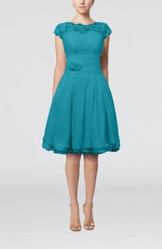 My bridesmaid dresses in teal.  They will wear white sparkly toms :)
