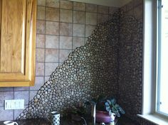 multi-colored tumbled travertine backsplash tile. | tile & natural