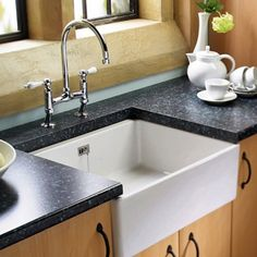 This is our collection of butler sinks. We have focused on the traditional ceramic butler sink, but we can also supply a large variety of stainless sink inserts for both over and undermount situations to suit your needs. Ceramic Kitchen Sinks, Kitchen Sink Storage, New Kitchen Cabinets, Butler Sink, Stainless Sink, New Countertops, Kitchen Remodel, Kitchen Design, Laundry Rooms