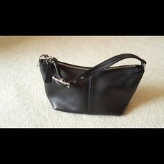 """Black leather coach shoulder bag Small black leather Coach shoulder bag. Used once or twice (seriously not more than that).  Approximately 11"""" X 6"""". Strap is 14"""" and has 3 adjustments. Includes leather extender that was purchased from Coach separately. Inside zipper pocket. Questions? Please ask. Smoke free and pet free home. Thanks so much for looking and please check out the rest of my closet. Coach Bags Shoulder Bags"""