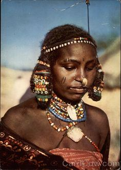 Africa | Portrait of a Kunama woman, Eritrea. ca. 1974 | This is an old post card image. Photographer unknown //