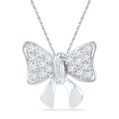 Give her all the love you hold in your heart - all tied up with a glittering bow! Fashioned in cool 10K white gold, this charming bow-shaped pendant is adorned with shimmering diamond accents that catch the eye. A bright and meaningful look, this 1/15 ct. t.w. diamond pendant is polished to a brilliant shine and suspends along an 18.0-inch rope chain that secures with a spring-ring clasp.