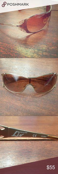 Oakley woman's sunglasses Oakley sunglasses. Gold rims. Nose pieces. No scratches in lenses. Oakley Accessories Sunglasses