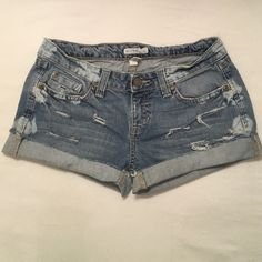 """Aeropostale Sz 3/4 distressed blue jean shorts 99% cotton 1% spandex. Aeropostale Sz 3/4 distressed destroy blue jean shorts-5- pockets-zip up fly-button closure. Bleach stains on front and back (see all pics) Handmade cut & fray distressed destroy look Please note: shorts use to be jeans.. Measurement laying flat waist 13 1/2"""" inseam cuff up 2"""" regular inseam 3"""" Aeropostale Shorts Jean Shorts"""