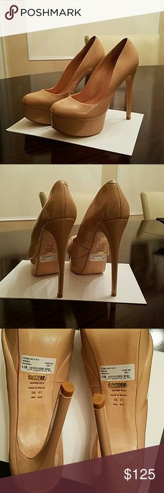 """Schutz """"Verniz Peach"""" Platform Stilleto Pump This beautiful nude full leather patent pump has a 1.5 inch platform and a 5.75 in heel.  This pump can be worn at the office with a pencil skirt or tapered slacks or """" ROCK"""" them with a pair of your favorite skinny jeans or leggings.  These pumps are new and unworn.  Only worn in the house but realized they were too big for me after throwing away the box !!!  My loss is your gain !!! Shoes Platforms"""