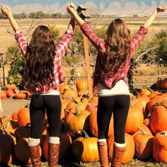 Everything about this picture! Love their outfits, pose, pumpkin patch and especially the hair! Celebrate Fall! We need to do this @Brielle M. Ferreira Hope