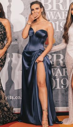 Red Carpet Fashion - Little Mix - Perrie Edwards - BRIT Awards 2019 <br> Perrie Edwards in midnight blue silk satin corseted gown with plunging strapless neckline and a floor length ruched skirt with thigh split and train Bella Hadid Red Carpet, Selena Gomez Red Carpet, Beyonce Red Carpet, Little Mix Perrie Edwards, Perrie Edwards Style, Fashion Fail, Fashion Weeks, Star Magic Ball Gowns, Looks Kim Kardashian