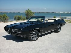 """1969 4-speed GTO Convertible -""""Elvira"""" - I bought my GTO in 2005 from Ebay. I have always wanted a BLACK 1969 4-speed GTO convertible. She's 100% number matching. One of 2403 manual trans cars made in 1969, ordered sparsely, with only seven options. I drive her almost every weekend, and have enjoyed her immensely.  Submitted by Kevin Guido"""