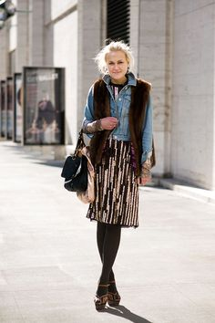 Love her style, interesting layers of vintage clothing.
