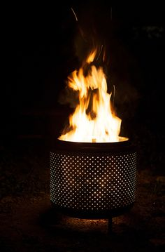 A firepit made out of a washing machine drum