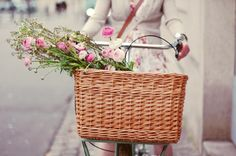 Bicycle rides + a wicker basket filled with flowers