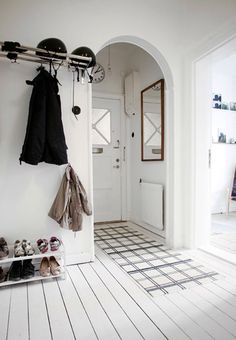 Simple and white arch entryway