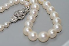Graduated+Cultured+Pearls+With+Diamond+Set+Clasp