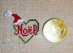 Grille point de croix offerte .pdf 'Petit coeur' Ainsi qu'un très joli carillon de Noël.