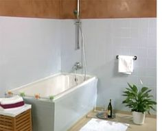 Painting bathroom tile!! For real?!! This could potentially save four grand if the tub could be painted to match. ( Ed. note: it can be ... see www.bathroom-paint.net/painting-bathroom-tiles.php )