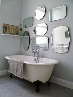 to hang a display of vintage mirrors frameless-mirror-wall-display. Also loving the soft grey and roll top bath with little shelf at the endframeless-mirror-wall-display. Also loving the soft grey and roll top bath with little shelf at the end Bathroom Mirror Design, Bathroom Styling, Small Bathroom, Master Bathroom, Bathroom Wall, Wooden Bathroom, Budget Bathroom, Bathroom Ideas, Brass Bathroom