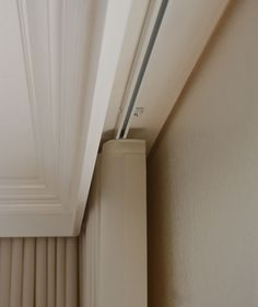 Ceiling molding detail to hide track for ripplefold draperies