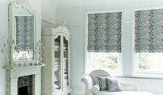 grey floral roman blinds in a white room