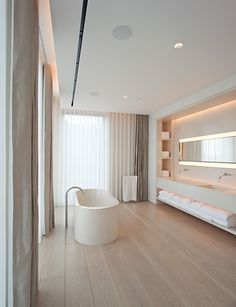 timber floors and curtains- bathrooms are surley becoming a room for total pampering and relaxation!