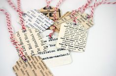 cute gift tags made from book pages on card stock, with a silver eyelet around the hole.