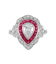 White Gold, Diamond and Ruby Ring   18 kt., one pear-shaped diamond ap. 1.02 cts., 19 rubies ap. 2.55 cts., ap. 3 dwt. Size 6 3/4.