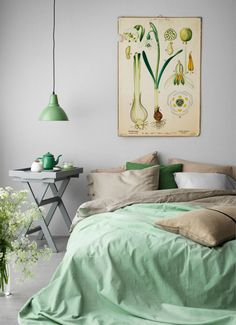 Coordinating greens makes this bedroom look gorgeous.
