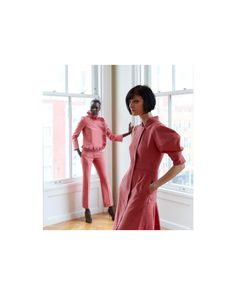 wears a sculptural jacket with micro pleats and pvc and flared boy pant in pink silk moiré and wears a zippered dress with constructed trapezoid sleeve in pink sul moiré during the Bond Street Demi-Couture presentation in New YorkPhotography by Bond Street, Boys Pants, Pink Silk, Presentation, High Neck Dress, Couture, Sleeves, How To Wear, Jackets