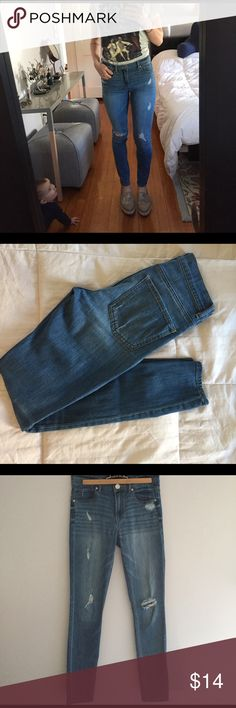 """High waist destructed denim leggings High waisted Express denim leggings in size 4 (27 equivalent) gently worn and loved. No unintentional ripping or tearing. 9"""" rise. 28"""" inseam. Functional pockets. Express Jeans Skinny"""