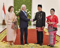 Indonesian President Joko Widodo (2nd R) and his wife Iriana (1st R) show a Bogor botanical graden to Swedish King Carl XVI Gustav (2nd L) and Queen Silvia during their visit in Bogor, West Java province, Indonesia, May 22, 2017.