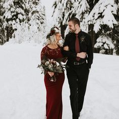 From the snowy setting to the ultra romantic color palette, every element makes us swoon.