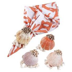 """Bring a pop of style to your tablescape with this eye-catching napkin ring, showcasing an ornate scallop shell design.    Product: Set of 4 napkin ringsConstruction Material: ShellColor: MultiFeatures: Scalloped edge designDimensions: 3.25"""" DiameterNote: Napkin not included"""