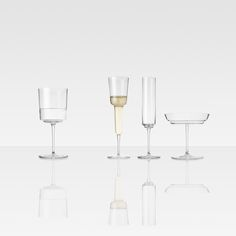 THREE CHAMPAGNE GLASSES AND ONE WATER GLASS