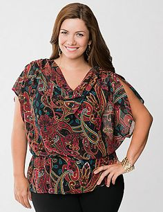 Sheer for trend-right layering with enough sophistication to take you anywhere, this paisley peplum blouse is a stunner. This figure-flattering silhouette plays up curves in all the right places with a draped neckline and elastic waist, plus a blousy fit that complements jeans, skirts and more. Feminine ruched shoulders and split short sleeves complete the look. lanebryant.com