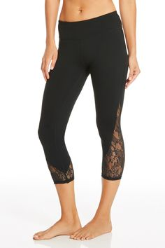 Don't call me cute. These lace detailed leggings may look sweet, but the performance factors are hardcore. Stretch, sweat and move in fall's must-have bottoms.