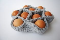 Crochet Egg Holder- Make one resemble a nest! It would be cute to make it brown & fill the holes with the confetti string before putting the Easter eggs.