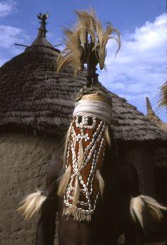 Africa    Masked performer wearing vertical Chi wara headdress, Bougouni village, Mali.  Photo taken by Eliot Elisofon in 1970.