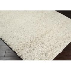 Aros textured area rug by Surya at Key Home Furnishings in Portland, OR.  This rug is available in multiple sizes, visit our website for more information!