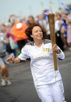 Sarah with the torch in Aldeburgh