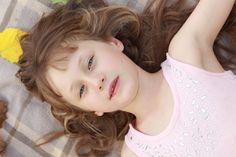 Child pose on blanket. Love her hair