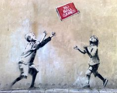 "Like most public Banksy pieces, ""No Ball Games"" is a mural created using stencils. It depicts two children with their hands reaching up, and a cardboard sign that reads ""No Ball Games."" The Sincura Group says an undisclosed party approached it about restoring the work."
