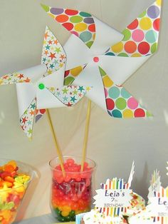 Colorful  pinwheels at a Rainbow Birthday Party!  See more party ideas at CatchMyParty.com!