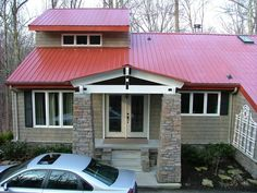 Country Red Metal Roof | Exterior of house. New red metal roof, stack rock columns, and vinyl ...