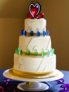 Zelda Wedding Cake. I love it, but I want to change the colors of the rupees. I'm thinking purple, silver, and gold.