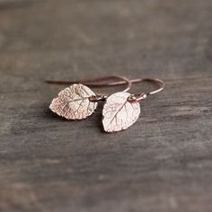 Tiny Rose Gold Leaf Earrings - Woodland Jewelry - Rose Gold Vermeil and Rose Gold Filled by burnish on Etsy https://www.etsy.com/listing/157778997/tiny-rose-gold-leaf-earrings-woodland
