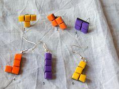 Boucles d'oreille et puces blocs de Tetris, réalisées par La Caverne des Geek sur A Little Market. N'hésitez pas à aller jeter un œil. =) https://www.alittlemarket.com/boutique/la_caverne_des_geek-1476567.html